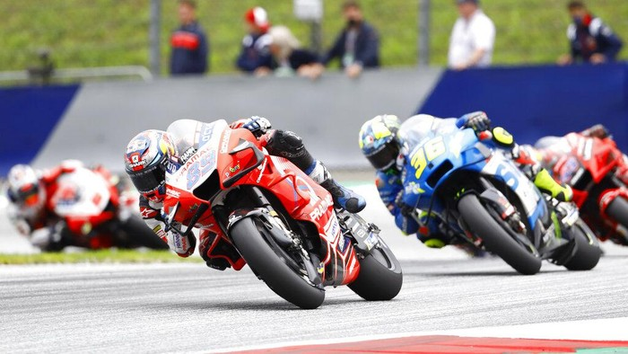 MotoGP rider Jorge Martin of Spain leads ahead of MotoGP rider Joan Mir of Spain during the MotoGP motorcycle race Grand Prix of Styria at the Red Bull Ring in Spielberg, Austria, Sunday, Aug. 8, 2021. (AP Photo/Gerhard Schiel)