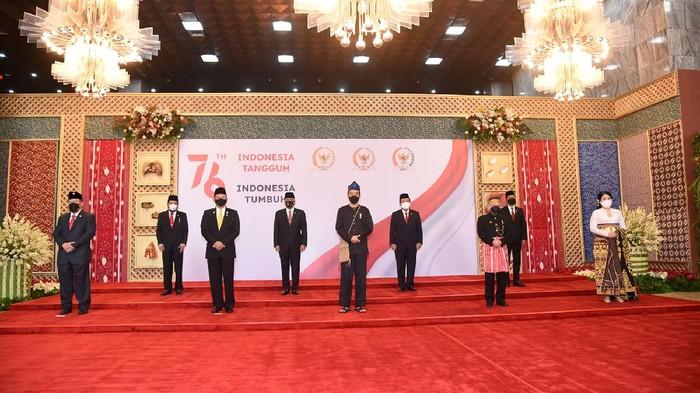 Presiden Joko Widodo (Jokowi) menghadiri sidang tahunan MPR 2021. Jokowi hadir dengan mengenakan baju adat suku Baduy.