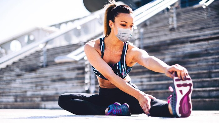 fitness woman stretching the legs