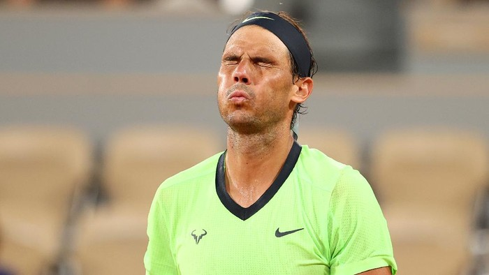 PARIS, FRANCE - JUNE 11: Rafael Nadal of Spain reacts during his Mens Singles Semi Final match against Novak Djokovic of Serbia on day Thirteen of the 2021 French Open at Roland Garros on June 11, 2021 in Paris, France. (Photo by Julian Finney/Getty Images)