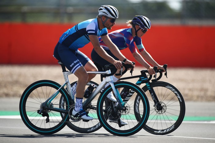 NORTHAMPTON, ENGLAND - JULY 30: Valtteri Bottas of Finland and Mercedes GP and girlfriend and road cyclist Tiffany Cromwell cycle on track during previews ahead of the F1 Grand Prix of Great Britain at Silverstone on July 30, 2020 in Northampton, England. (Photo by Bryn Lennon/Getty Images)