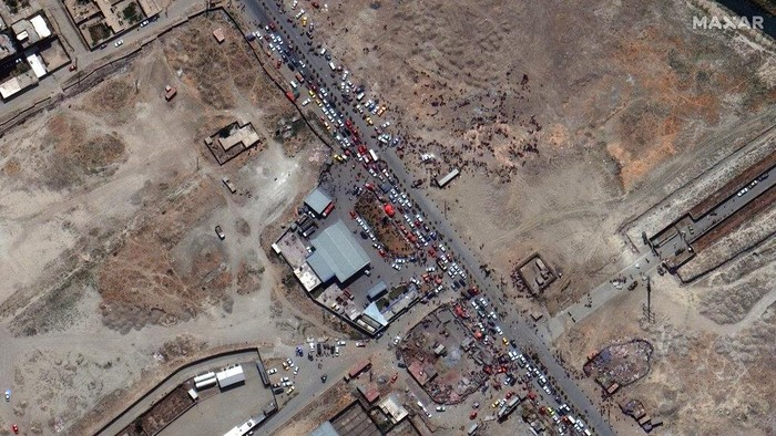 This satellite image provided by Maxar Technologies shows crowds and traffic at the northern gate of Kabul's international airport on Monday, Aug. 23, 2021. (Satellite Image ©2021 Maxar Technologies via AP)