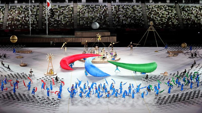 TOKYO, JAPAN - AUGUST 24: Performers dance during the opening ceremony of the Tokyo 2020 Paralympic Games at the Olympic Stadium on August 24, 2021 in Tokyo, Japan. (Photo by Naomi Baker/Getty Images)