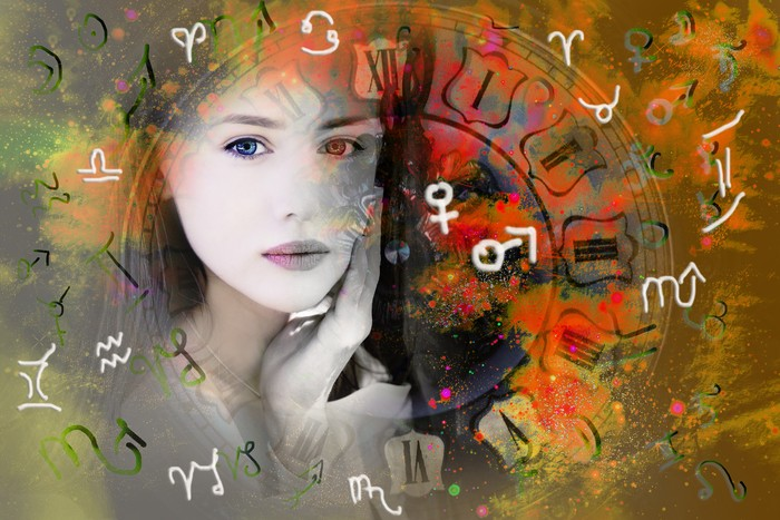 Female face, space and zodiac signs and planets symbols.