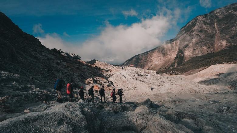 Garut - Indonesia - July 9, 2018 : Group of Hikers Walking in Papandayan Mountain Garut Indonesia