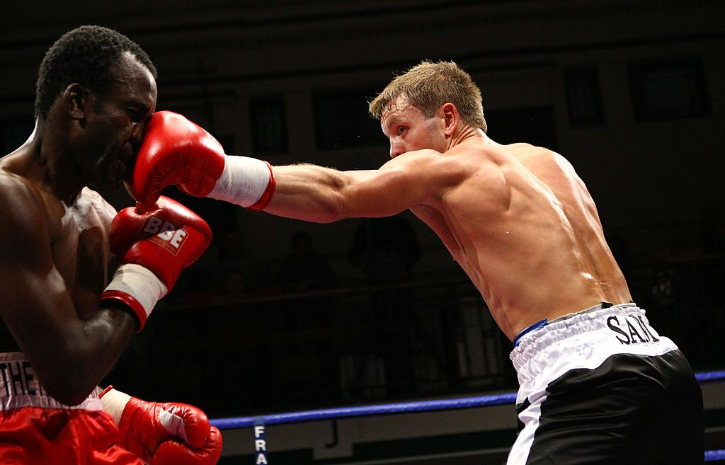 BELFAST, IRELAND - MAY 20:  Mehrdud Takaloo of Iran (L) connects with a jab against Eamonn Magee of Northern Ireland during the WBU Welterweight title fight between Eamonn Magee and Takaloo at the Kings Hall on May 20, 2006 in  Belfast, Ireland. (Photo by John Gichigi/Getty Images)