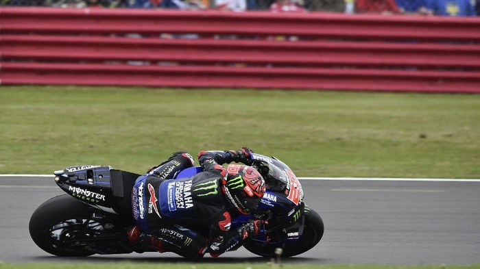 Frances rider Fabio Quartararo of the Monster Energy Yamaha MotoGP steers his motorcycle during the MotoGP race at the British Motorcycle Grand Prix at the Silverstone racetrack, in Silverstone, England, Sunday, Aug. 29, 2021. (AP Photo/Rui Vieira)