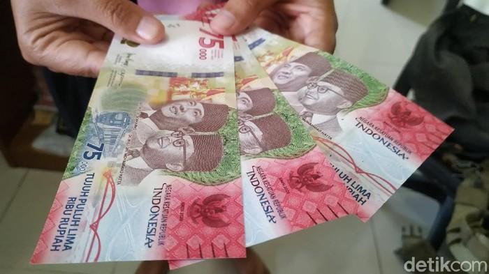 Uang pecahan Rp 75 ribu.