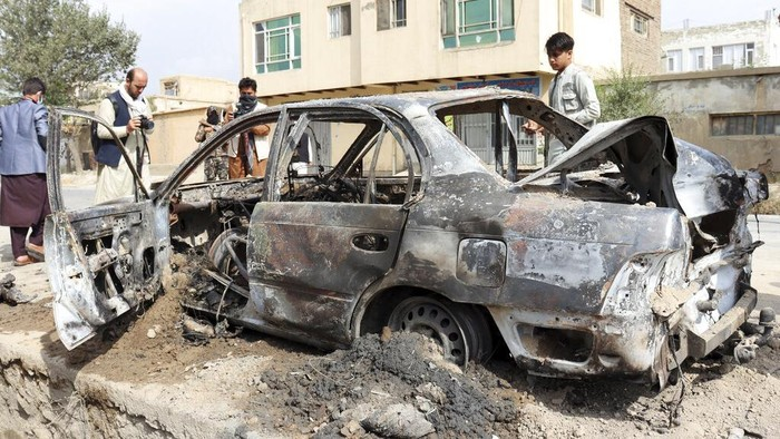 Rocket launcher tubes are seen in a destroyed vehicle vehicle in Kabul, Afghanistan, Monday, Aug. 30, 2021. Rockets struck a neighborhood near Kabul's international airport on Monday amid the ongoing U.S. withdrawal from Afghanistan. It wasn't immediately clear who launched them. (AP Photo/Khwaja Tawfiq Sediqi)