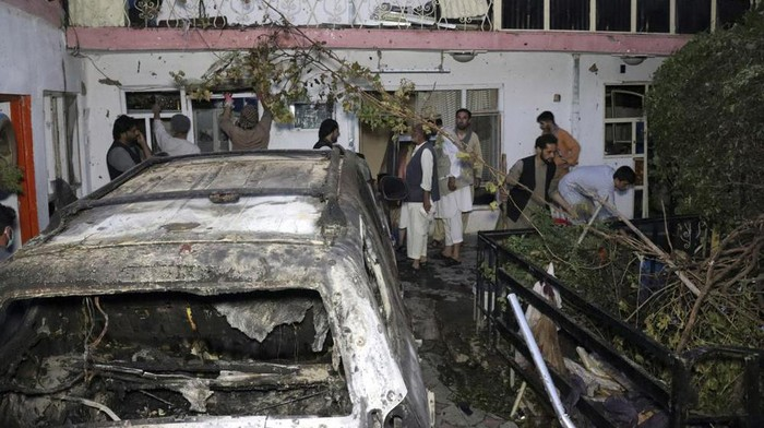 Afghan people are seen inside a house after U.S. drone strike in Kabul, Afghanistan, Sunday, Aug. 29, 2021. A U.S. drone strike destroyed a vehicle carrying