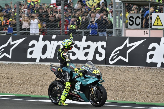 Italian rider Valentino Rossi of the Petronas Yamaha SRT waves to fans after the MotoGP race at the British Motorcycle Grand Prix at the Silverstone racetrack, in Silverstone, England, Sunday, Aug. 29, 2021. (AP Photo/Rui Vieira)