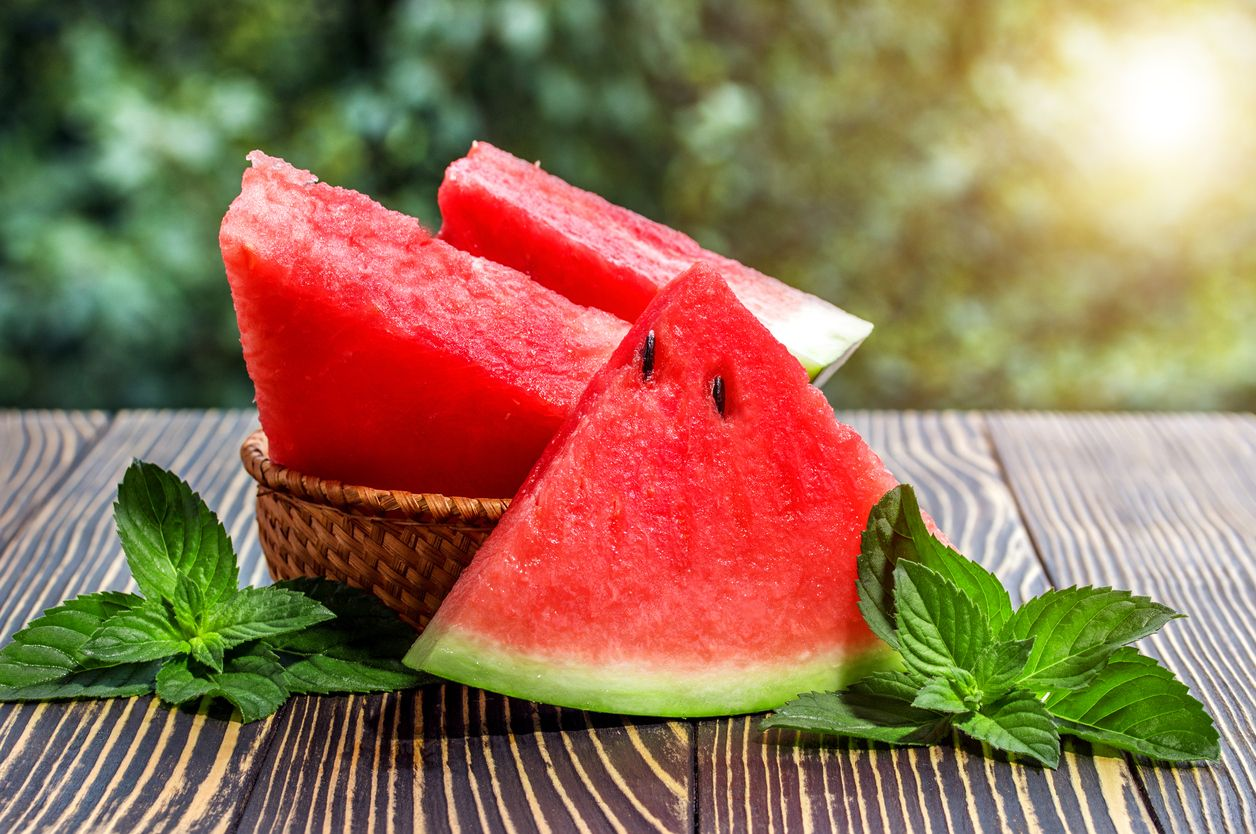 Fresh sliced watermelon wooden  old background