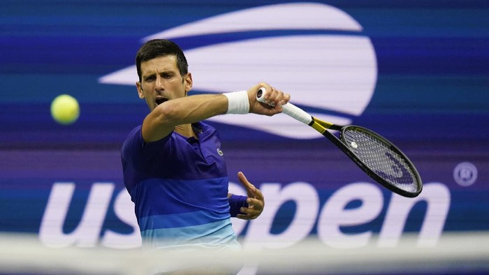 Novak Djokovic, of Serbia, returns a shot during the first round of the US Open tennis championships, Tuesday, Aug. 31, 2021, in New York. (AP Photo/Frank Franklin II)