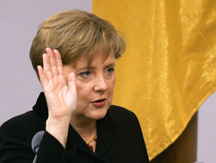 In this Tuesday, Nov. 22, 2005 file photo, newly appointed German chancellor Angela Merkel takes the oath of office at the parliament Bundestag in Berlin. Angela Merkel, now Chancellor of Germany, will leave office as one of modern Germany's longest-serving leaders and a global diplomatic heavyweight, with a legacy defined by her management of a succession of crises that shook a fragile Europe rather than any grand visions for her own country. (AP Photo/Fritz Reiss)