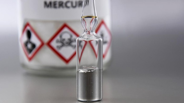 Laboratory accessories images. Mercury in a sealed ampoule stock photo. Laboratory equipment on a silver background. Hg, toxic chemical element stock images