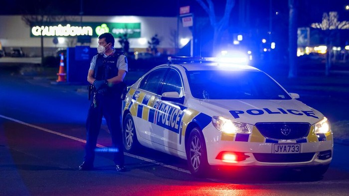 Police stand outside the site of a knife attack at a supermarket in Auckland, New Zealand, Friday, Sept. 3, 2021. New Zealand authorities say they shot and killed a violent extremist after he entered the supermarket and stabbed and injured six shoppers. New Zealand Prime Minister Jacinda Ardern described Friday's incident as a terror attack. (AP Photo/Brett Phibbs)
