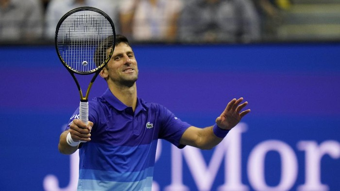 Novak Djokovic, of Serbia, reacts after hitting Tallon Griekspoor, of the Netherlands, with the ball while returning a shot during the second round of the US Open tennis championships, Thursday, Sept. 2, 2021, in New York. (AP Photo/Frank Franklin II)