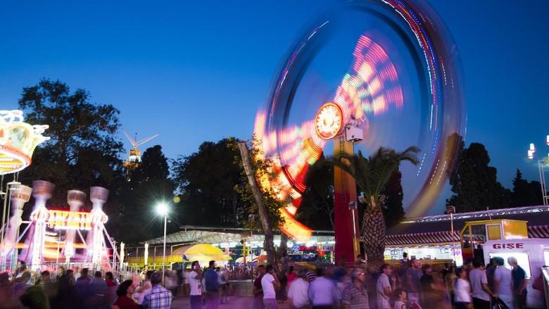 Izmir, Turkeyy - August 30, 2014: Amusement park and crowded people enjoying. Izmir international fair 2014. August 30 2014 Izmir Turkey