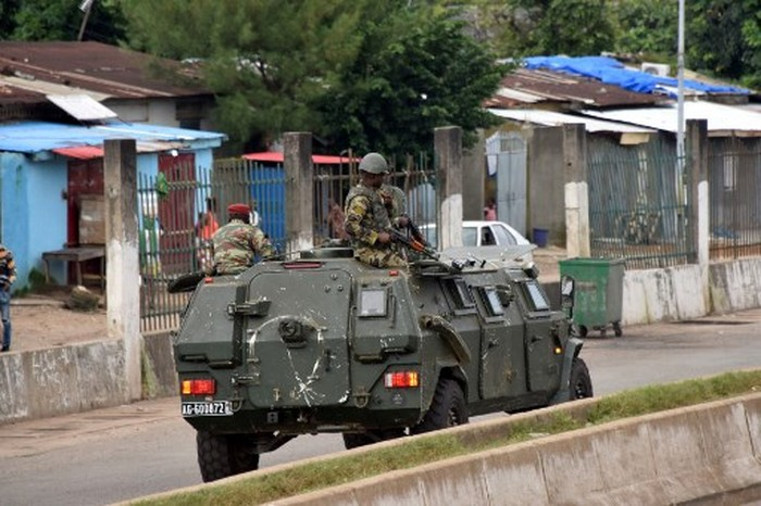 Members of the Armed Forces of Guinea drive through the central neighbourhood of Kaloum in Conakry on September 5, 2021 after sustainable gunfire was heard. - Gunfire was heard in Conkary in the morning and troops were seen on the streets, witnesses told AFP. There was no immediate explanation for the incidents in Conakrys Kaloum peninsula, where the presidency, various institutions and offices are located. (Photo by CELLOU BINANI / AFP)