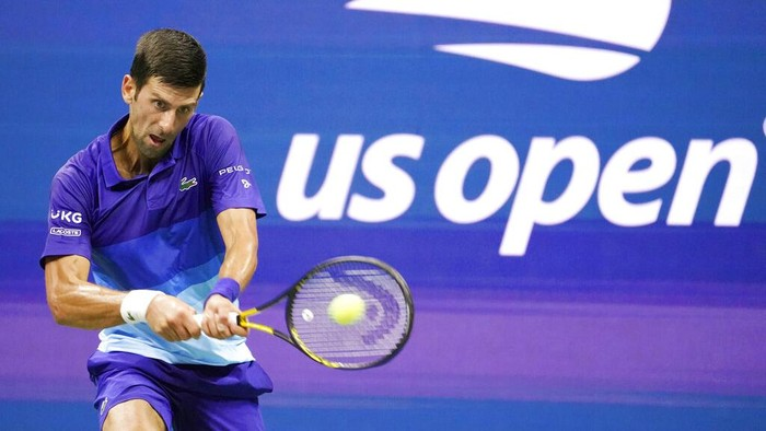 Novak Djokovic, of Serbia, returns against Jenson Brooksby, of the United States, during the fourth round of the US Open tennis championships, Monday, Sept. 6, 2021, in New York. (AP Photo/John Minchillo)