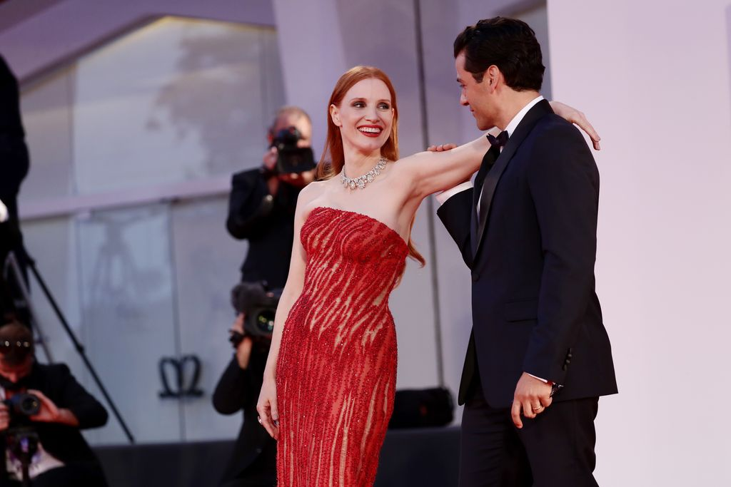 VENICE, ITALY - SEPTEMBER 04: Jessica Chastain and Oscar Isaac attend the red carpet of the movie
