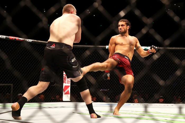 SYDNEY, AUSTRALIA - NOVEMBER 19:  Elias Theodorou (R) of Canada kicks Daniel Kelly (R) of Australia in their middleweight bout during the UFC Fight Night at Qudos Bank Arena on November 19, 2017 in Sydney, Australia.  (Photo by Mark Kolbe/Getty Images)