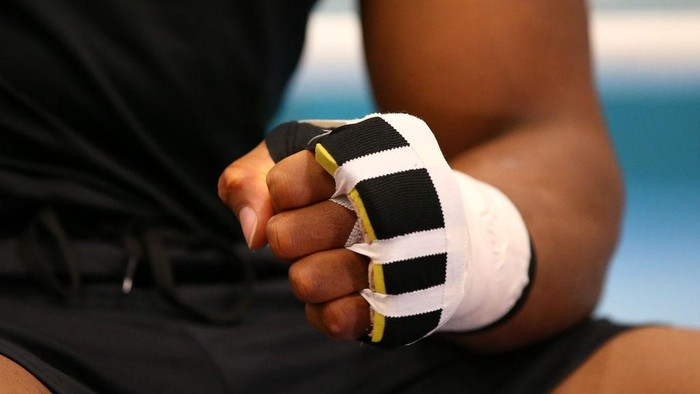 SHEFFIELD, ENGLAND - MAY 01: A detail shot of Anthony Joshuas fist is seen as he tapes up prior to a training session during the Anthony Joshua Media Day at the English Institute of Sport on May 01, 2019 in Sheffield, England. (Photo by Alex Livesey/Getty Images)