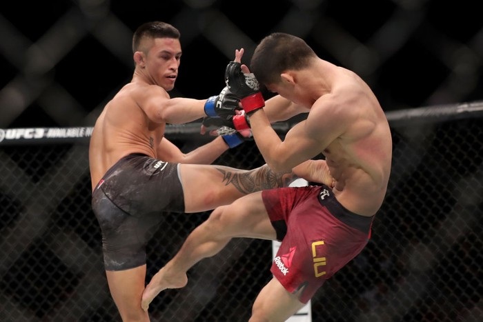 BEIJING, CHINA - NOVEMBER 24:  (L-R) Martin Day kicks Liu Pingyuan of China in their bantamweight bout during the UFC Fight Night event at Cadillac Arena on November 24, 2018 in Beijing, China.  (Photo by Emmanuel Wong/Getty Images)