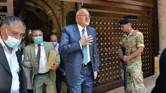 Prime Minister-designate Najib Mikati leaves the al-Omari mosque in the Lebanese capital Beirut on September 10, 2021, ahead of meeting with the Lebanese President. (Photo by - / AFP)
