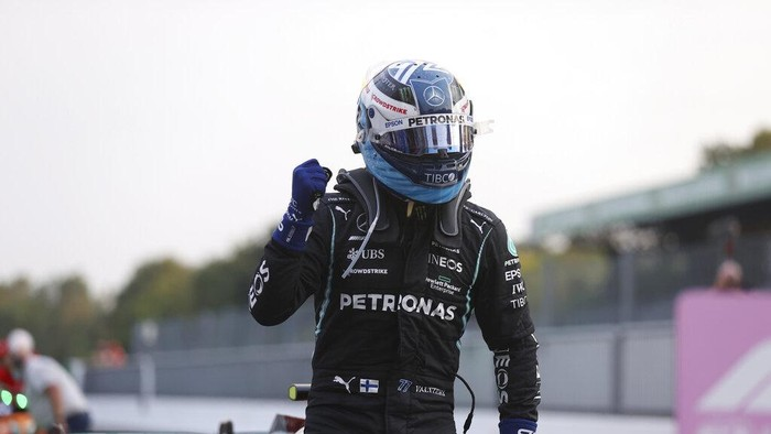 Mercedes driver Valtteri Bottas of Finland reacts after he clocked the fastest time during the qualifying session at the Monza racetrack, in Monza, Italy , Friday, Sept.10, 2021. The Formula one race will be held on Sunday. (Lars Baron/Pool photo via AP)