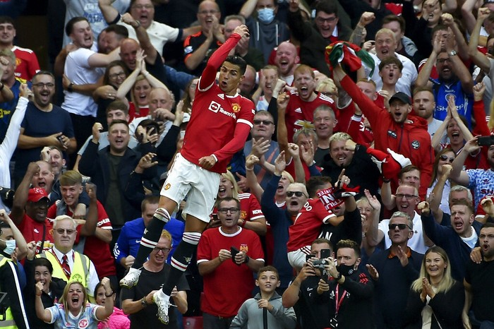 Manchester Uniteds Cristiano Ronaldo celebrates after scoring his sides second goal during the English Premier League soccer match between Manchester United and Newcastle United at Old Trafford stadium in Manchester, England, Saturday, Sept. 11, 2021. (AP Photo/Rui Vieira)