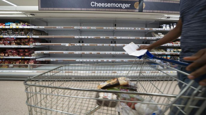 A view of empty shelves at a Tesco supermarket in Manchester, England, Sunday, Sept 12, 2021. Retailers, manufacturers and food suppliers have also reported disruptions due to a shortage of truck drivers linked to the pandemic and Britain's departure from the European Union, which has made it harder for many Europeans to work in the U.K. (AP Photo/Jon Super)