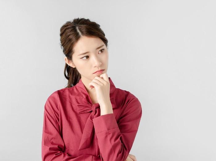 Thinking asian woman.