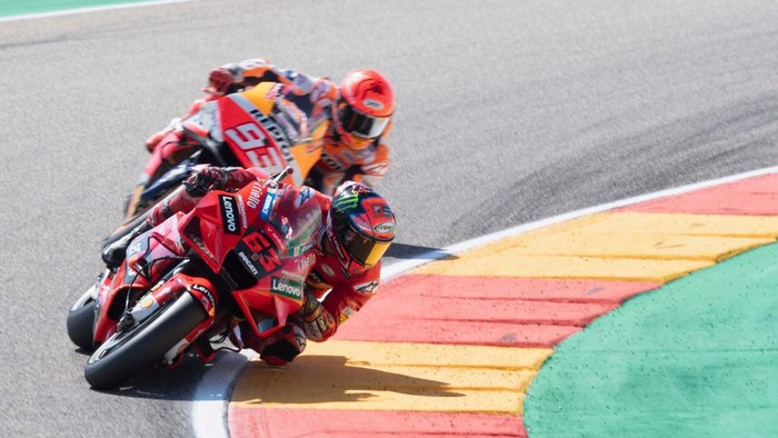 ALCANIZ, SPAIN - SEPTEMBER 12: Francesco Bagnaia of Italy and Ducati Lenovo Team leads Marc Marquez of Spain and Repsol Honda Team  during the MotoGP race during the MotoGP of Aragon - Race at Motorland Aragon Circuit on September 12, 2021 in Alcaniz, Spain. (Photo by Mirco Lazzari gp/Getty Images)