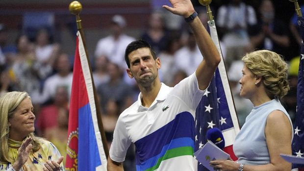 Novak Djokovic, of Serbia, center, waves to the crowd after losing to Daniil Medvedev, of Russia, in the men's singles final of the US Open tennis championships, Sunday, Sept. 12, 2021, in New York. (AP Photo/Elise Amendola)