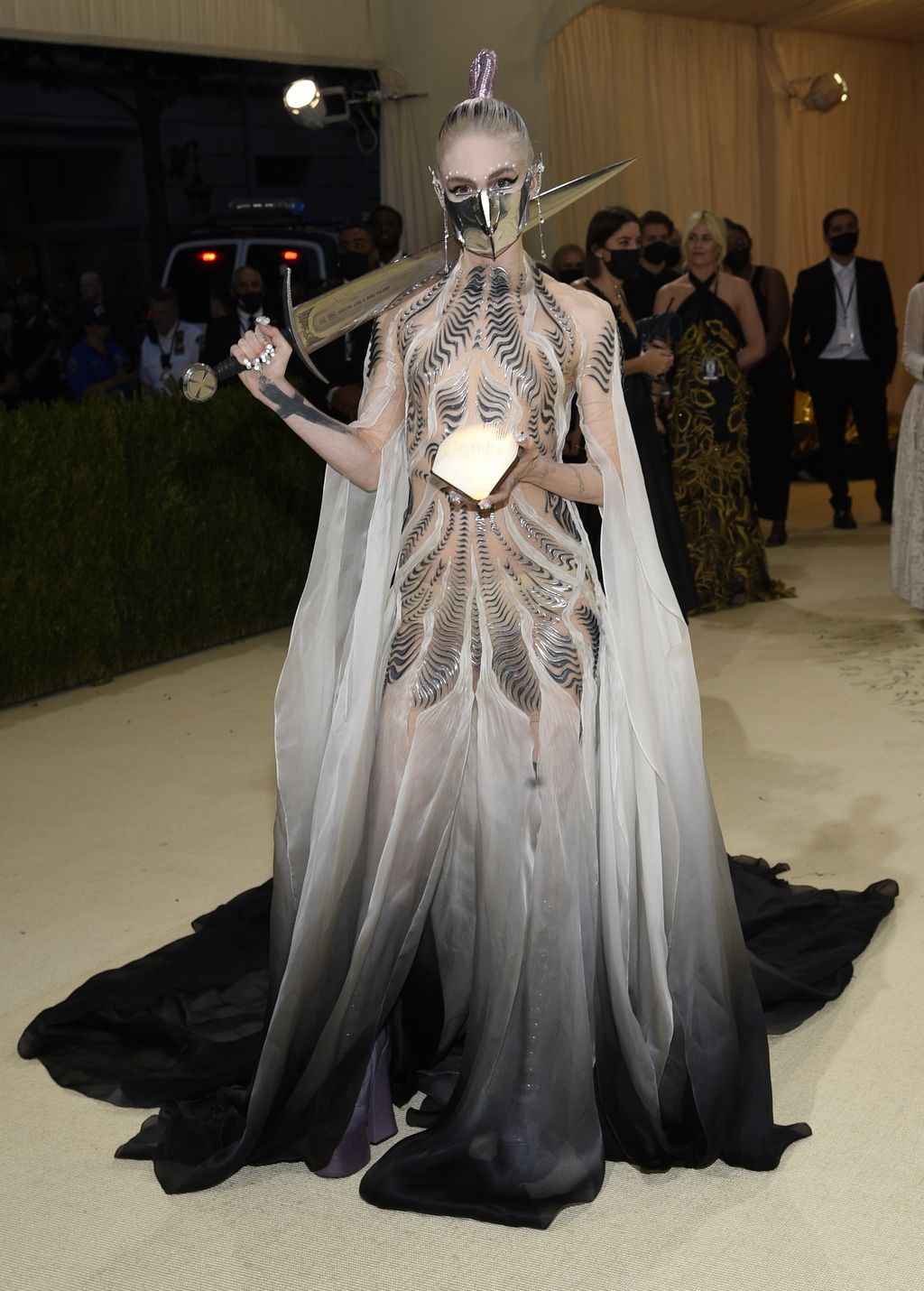 Grimes attends The Metropolitan Museum of Art's Costume Institute benefit gala celebrating the opening of the