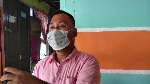 Ketua RT di Palembang, Amran (M Syahbana-detikcom)