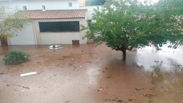 A tree stands amongst flood waters in Aigues-Vives, Gard, France September 14, 2021, in this screen grab obtained from a social media video. @STAWIXBLINK/via REUTERS THIS IMAGE HAS BEEN SUPPLIED BY A THIRD PARTY. MANDATORY CREDIT. NO RESALES. NO ARCHIVES.