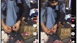 Jijik! Pedagang Ini Potong Daging dengan Pisau di Kakinya
