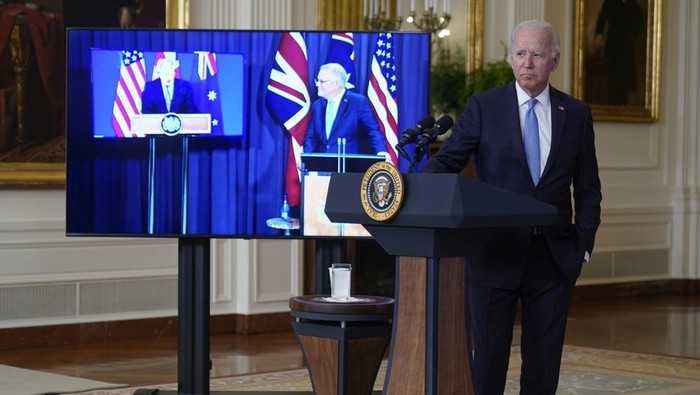 President Joe Biden, joined virtually by Australian Prime Minister Scott Morrison, right on screen, and British Prime Minister Boris Johnson, speaks about a national security initiative from the East Room of the White House in Washington, Wednesday, Sept. 15, 2021. (AP Photo/Andrew Harnik)