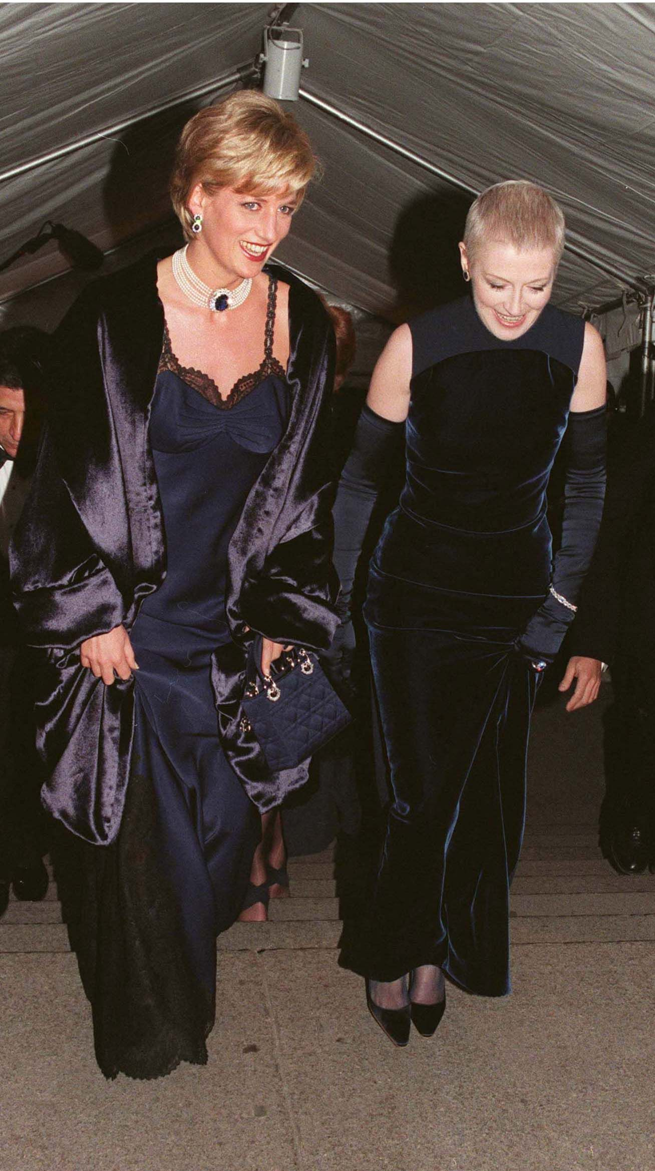 NEW YORK - DECEMBER 09:  Diana, Princess of Wales, wearing a John Galliano dress, arrives with her friend Liz Tilberis for a Costume Institute Ball at the Metropolitan Museum of Art on December 09, 1996 in New York, USA. (Photo by Anwar Hussein/Getty Images)
