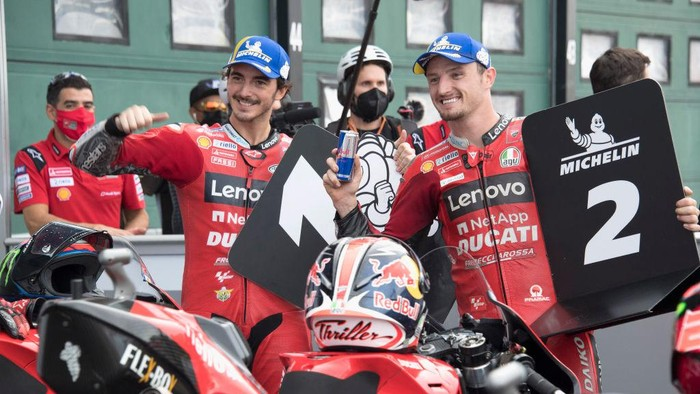 MISANO ADRIATICO, ITALY - SEPTEMBER 18: Jack Miller of Australia and Ducati Lenovo Team and Francesco Bagnaia of Italy and Ducati Lenovo Team (L) celebrate at the end of the MotoGP qualifying practice during the MotoGP Of San Marino - Qualifying at Misano World Circuit on September 18, 2021 in Misano Adriatico, Italy. (Photo by Mirco Lazzari gp/Getty Images)