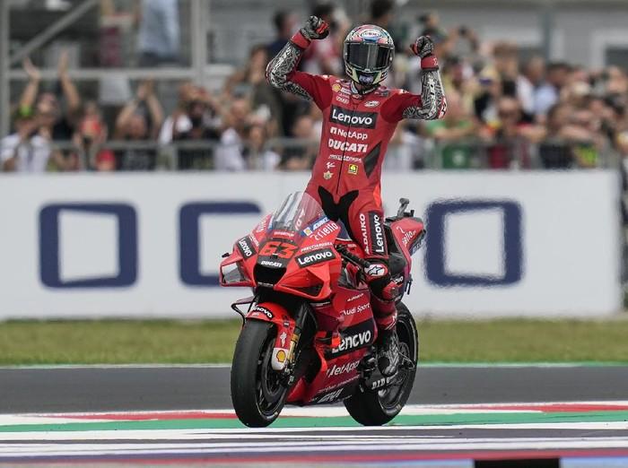 Italys Francesco Bagnaia rides his Ducati as he celebrates winning the San Marino MotoGP race, at the Misano circuit in Misano Adriatico, Italy, Sunday, Sept. 19, 2021. (AP Photo/Antonio Calanni)