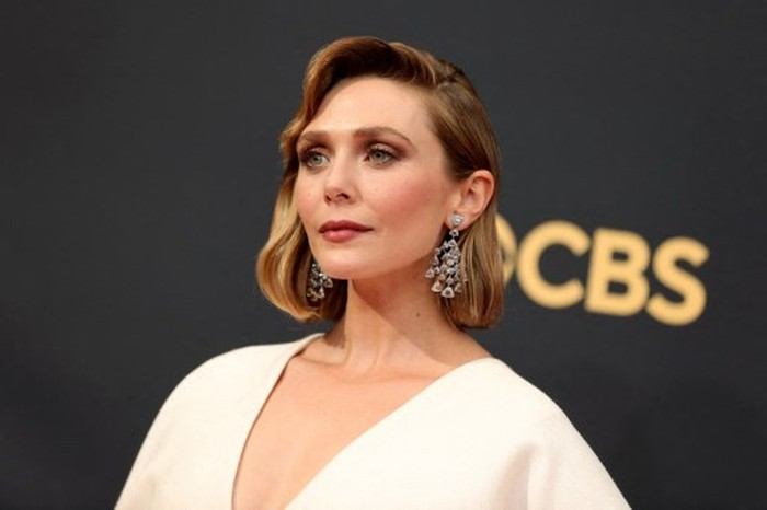 LOS ANGELES, CALIFORNIA - SEPTEMBER 19: Elizabeth Olsen attends the 73rd Primetime Emmy Awards at L.A. LIVE on September 19, 2021 in Los Angeles, California.   Rich Fury/Getty Images/AFP (Photo by Rich Fury / GETTY IMAGES NORTH AMERICA / Getty Images via AFP)