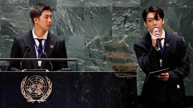 RM listens as Jungkook of the South Korean boy band BTS speaks at the SDG Moment event as part of the UN General Assembly 76th session General Debate in UN General Assembly Hall at the United Nations Headquarters, in New York, U.S., September 20, 2021. John Angelillo/Pool via REUTERS