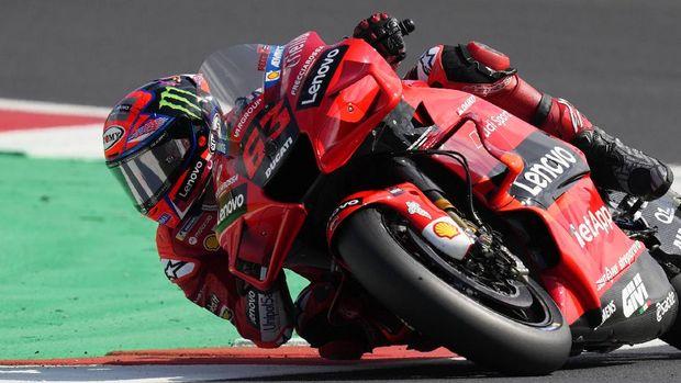 Italy's Francesco Bagnaia rides his Ducati during the MotoGP practice session for Sunday's San Marino Motorcycle Grand Prix at the Misano circuit in Misano Adriatico, Italy, Saturday, Sept. 18, 2021. (AP Photo/Antonio Calanni)