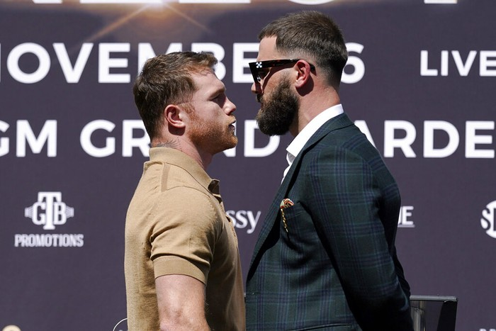 Unified WBC/WBO/WBA super middleweight champion Canelo Alvarez, left, faces off with undefeated IBF Super Middleweight Champion Caleb Plant during a news conference Tuesday, Sept. 21, 2021, in Beverly Hills, Calif. to announce their 168-pound title bout. The fight is scheduled for Saturday, Nov. 6 in Las Vegas. (AP Photo/Mark J. Terrill)