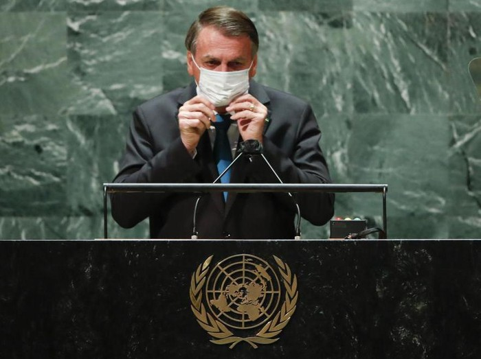 Brazils President Jair Bolsonaro puts back on a protective face mask after speaking during the 76th Session of the United Nations General Assembly at U.N. headquarters in New York on Tuesday, Sept. 21, 2021. (Eduardo Munoz/Pool Photo via AP)
