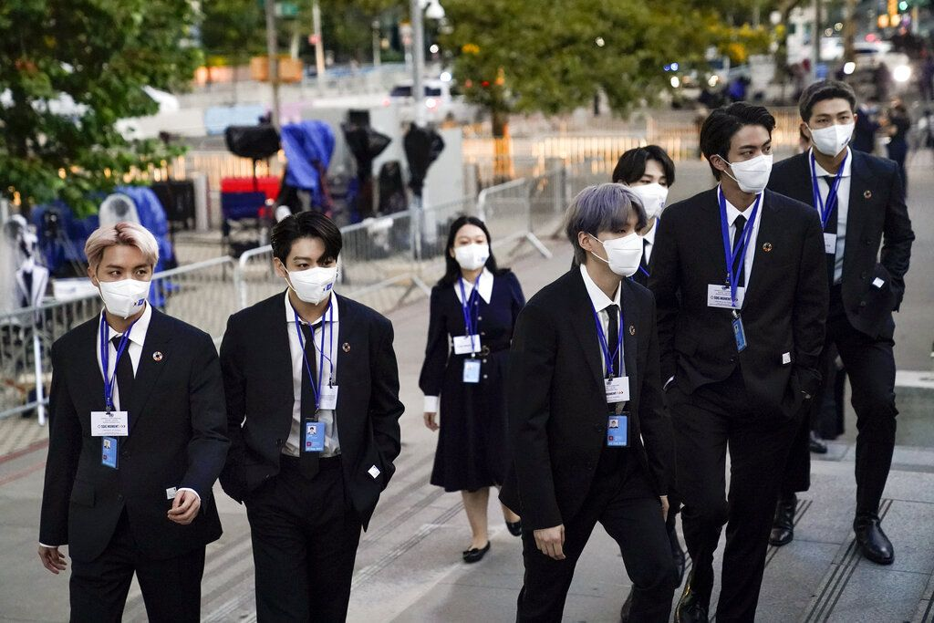 ADDS IDS - Members of the South Korean band BTS, from left, J-Hope, Jung Kook, Suga, Jimin, partially obscured, Jin and RM arrive to security check-in at United Nations headquarters, Monday, Sept. 20, 2021, during the 76th Session of the U.N. General Assembly in New York. (AP Photo/John Minchillo, Pool)