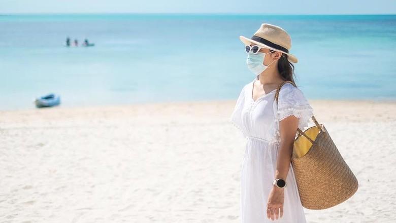 Ilustrasi liburan ke pantai.